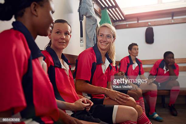 womens rugby players bonding before game - rugby players in changing room stock photos and pictures
