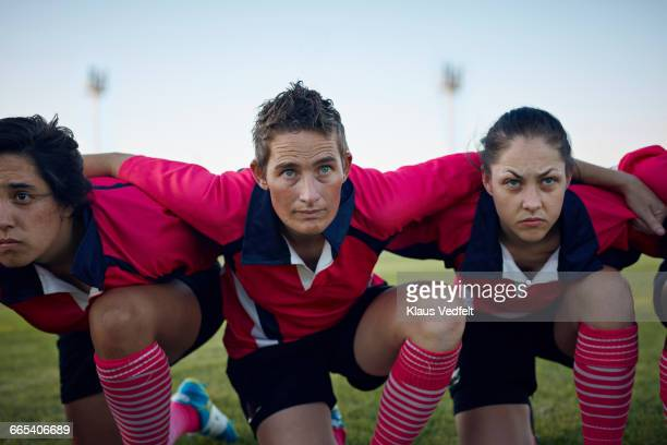 Womens rugby team kneeling together