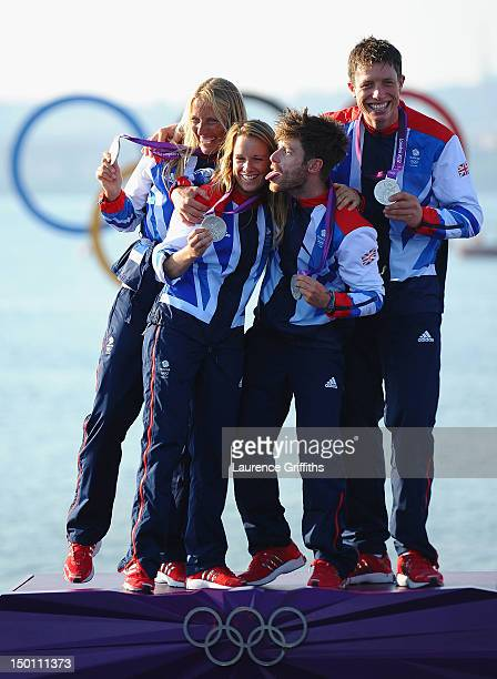 470 Women's sailors Saskia Clark and Hannah Mills of Great Britain and 470 Men's sailors Luke Patience and Stuart Bithell of Great Britain celebrate...
