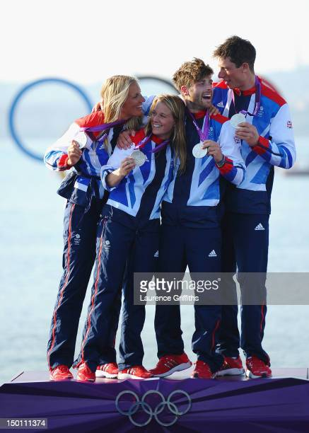 470 Women's sailors Saskia Clark and Hannah Mills of Great Britain and 470 Men's sailors Luke Patience and Stuart Bithell of Great Britain celebrate...