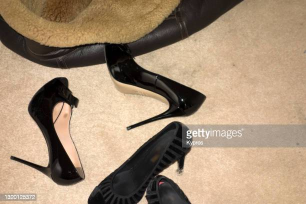 women's shoes on carpeted floor - uk - womenswear stock pictures, royalty-free photos & images
