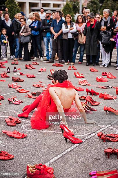 CONTENT] Women's shoes red exposed through the streets squares and monuments of the city to saying stop to gender violence Red as the blood that...