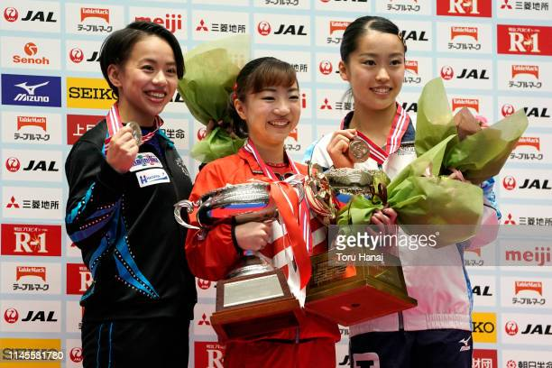 Women's silver medalist Mai Murakami gold medalist Asuka Teramoto and bronze medalist Hitomi Hatakeda pose on the podium at the medal ceremony on day...