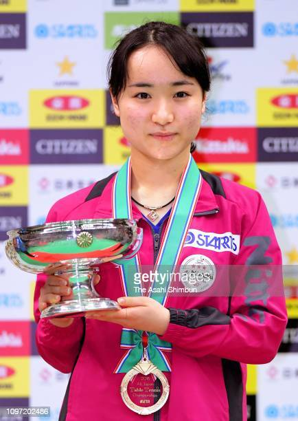 Women's Singles winner Mima Ito poses for photographs with the trophy after day seven of the All Japan Table Tennis Championships at Maruzen Intec...