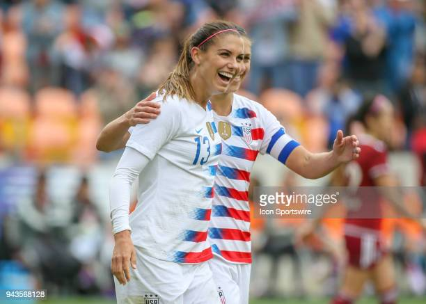 S Women's Soccer forward Alex Morgan and US Women's Soccer midfielder Carli Lloyd celebrate a goal scored in the 44th minute during the soccer match...