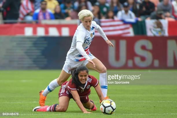 S Women's Soccer forward Megan Rapinoe hurdles Mexico National Team midfielder Cristina Ferral as she hustles after the ball during the soccer match...
