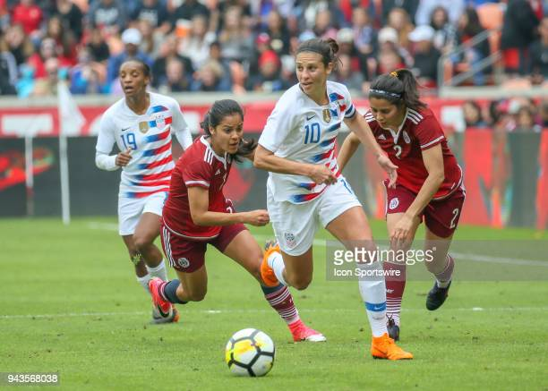 S Women's Soccer midfielder Carli Lloyd dribbles the ball past Mexico National Team defender Kenti Robles during the soccer match between the USA and...