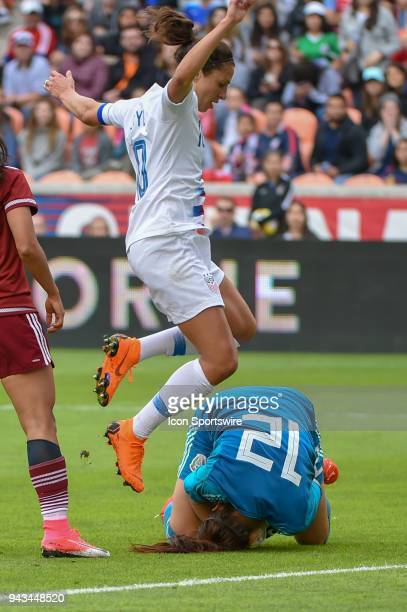 S Women's Soccer midfielder Carli Lloyd hurdles Mexico National Team goalkeeper Cecilia Santiago after making a first half save during the soccer...
