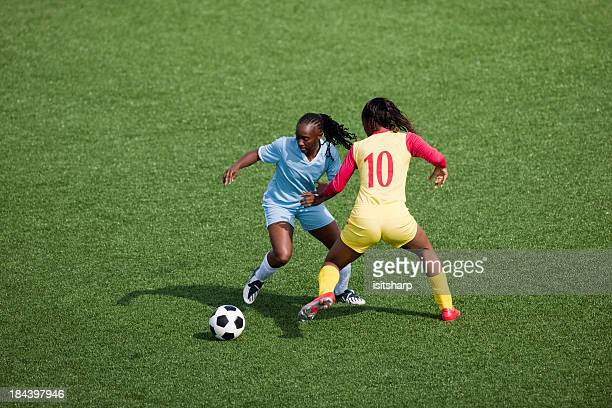 womens soccer - soccer striker stock pictures, royalty-free photos & images