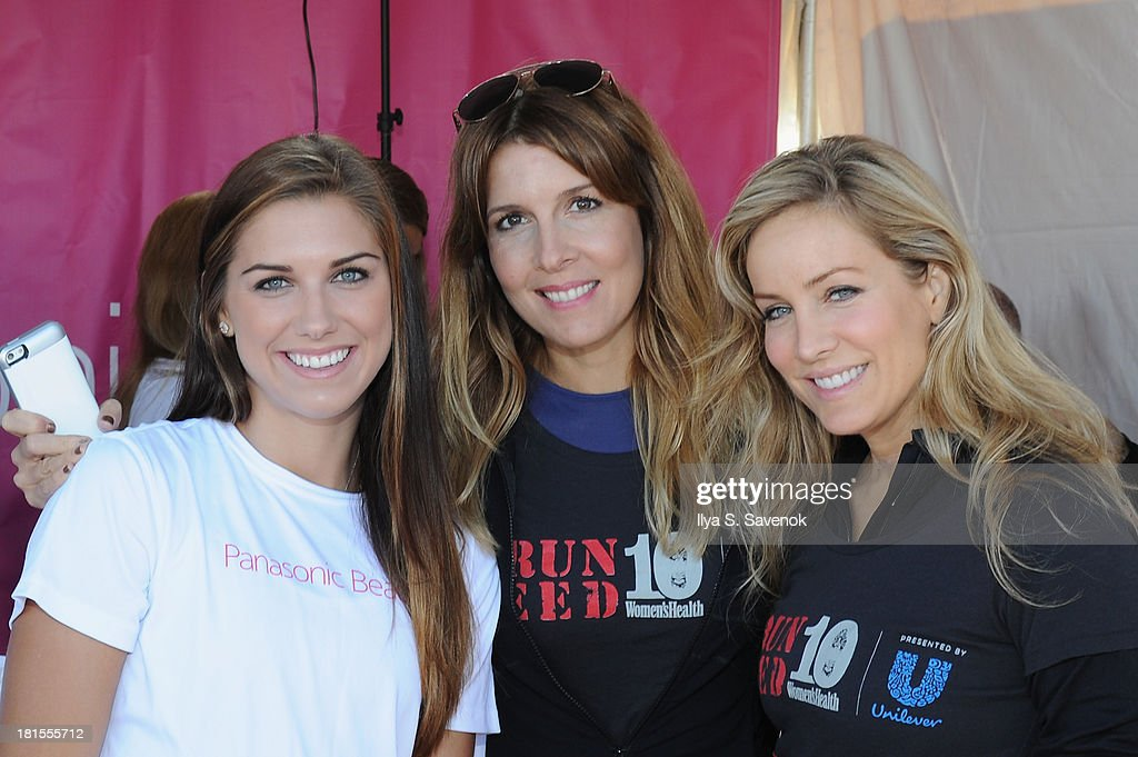 US womens soccer player Alex Morgan, Editor In Chief of Women's Health, Michele Promaulayko and Women's Health publisher, Laura Frerer-Schmidt attend Women's Health Magazine RUN10 FEED10 NYC 10K Race Event at Pier 84 on September 22, 2013 in New York City.