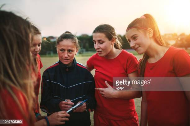 women's soccer team - coach stock pictures, royalty-free photos & images
