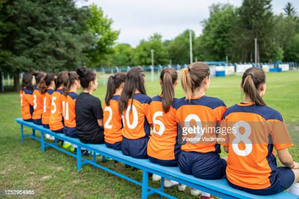 women's soccer team rear view - football face mask stock pictures, royalty-free photos & images
