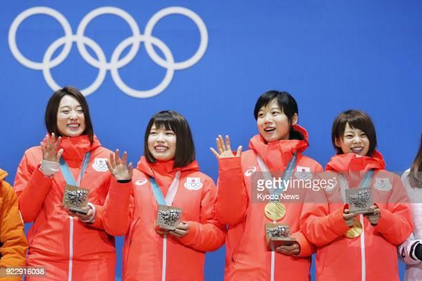 Women's speed skating team pursuit gold medalists Nana Takagi Miho Takagi Ayano Sato and Ayaka Kikuchi of Japan attend the medal ceremony at the...