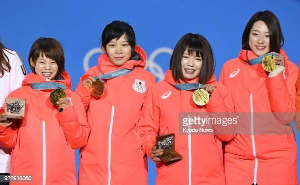 Women's speed skating team pursuit gold medalists Nana Takagi Miho Takagi Ayano Sato and Ayaka Kikuchi of Japan pose at the medal ceremony at the...