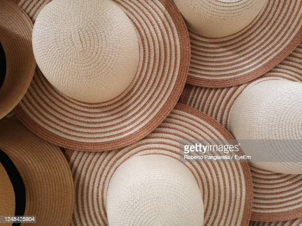 women's straw hats for sale - straw hat stock pictures, royalty-free photos & images
