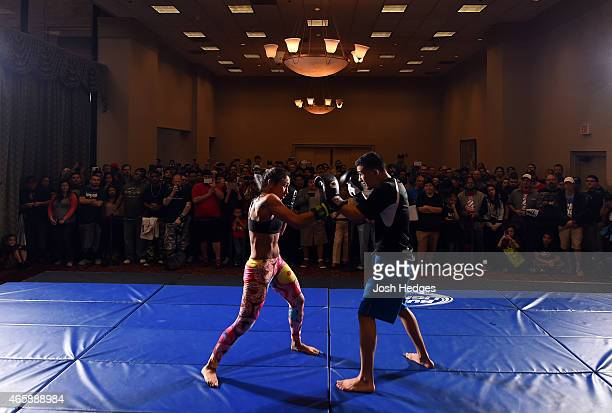 UFC women's strawweight champion Carla Esparza holds an open training session for fans and media at the Hilton Anatole Hotel on March 11 2015 in...