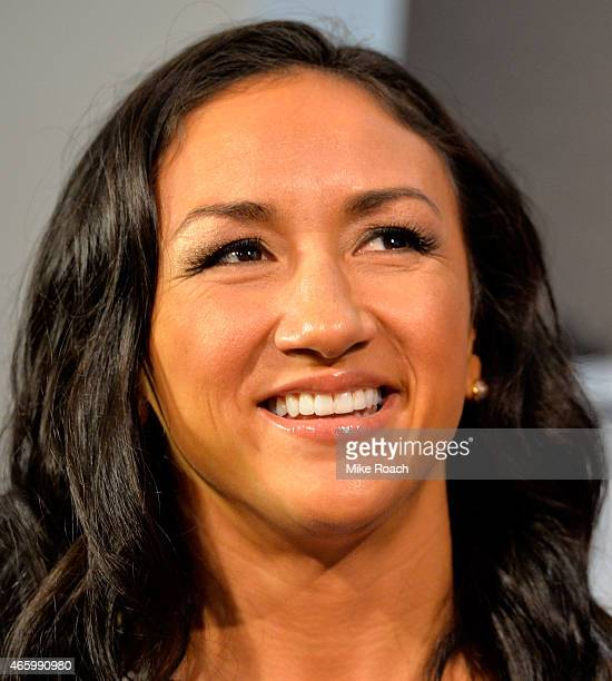 UFC women's strawweight champion Carla Esparza interacts with media during the UFC 185 Ultimate Media Day at the American Airlines Center on March 12...