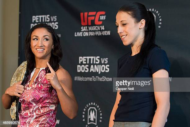 UFC women's strawweight champion Carla Esparza smiles at opponent Joanna Jedrzejczyk during the UFC 185 Ultimate Media Day at the American Airlines...