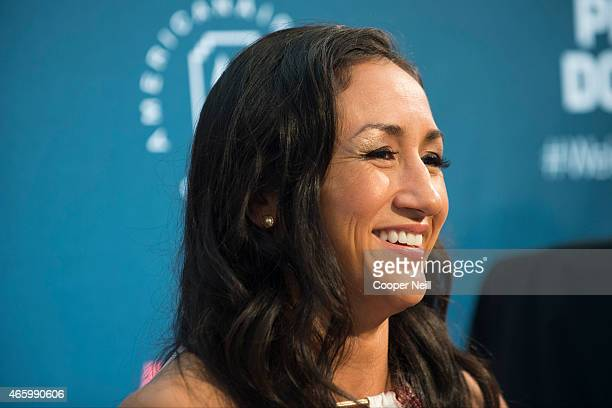 UFC women's strawweight champion Carla Esparza speaks with the media during the UFC 185 Ultimate Media Day at the American Airlines Center on March...