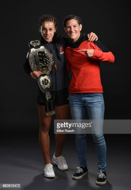 UFC women's strawweight champion Joanna Jedrzejczyk and Cortney Casey pose for a post fight portrait backstage during the UFC 211 event at the...