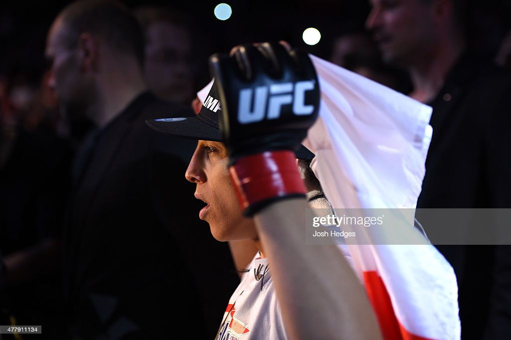 UFC women's strawweight champion Joanna Jedrzejczyk of Poland enters the arena before facing Jessica Penne of the United States in their women's strawweight championship bout during the UFC Fight Night event at the O2 World on June 20, 2015 in Berlin, Germany.