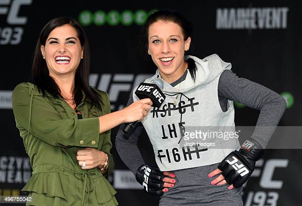 UFC women's strawweight champion Joanna Jedrzejczyk of Poland is interviewed by Megan Olivi after an open workout for fans and media at Federation...