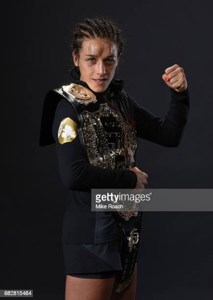 UFC women's strawweight champion Joanna Jedrzejczyk poses for a post fight portrait backstage during the UFC 211 event at the American Airlines...