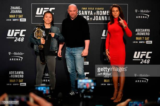 UFC women's strawweight champion Zhang Weili of China and Joanna Jedrzejczyk of Poland pose for media during the UFC 248 Ultimate Media Day at UFC...