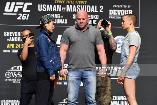 Women's Strawweight Champion Zhang Weili of China and Rose Namajunas face off during the UFC 261 press conference at VyStar Veterans Memorial Arena...