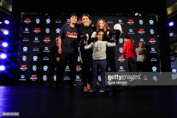 UFC women's strawweight contender Alexa Grasso of Mexico poses with a young fans during an open training session at Mall Sport on May 16 2018 in...