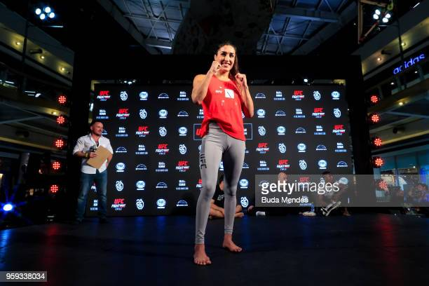 UFC women's strawweight contender Tatiana Suarez of the United States poses for photographers during an open training session at Mall Sport on May 16...