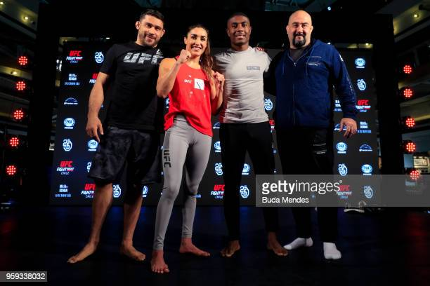 UFC women's strawweight contender Tatiana Suarez of the United States with her teammates pose for photographers during an open training session at...