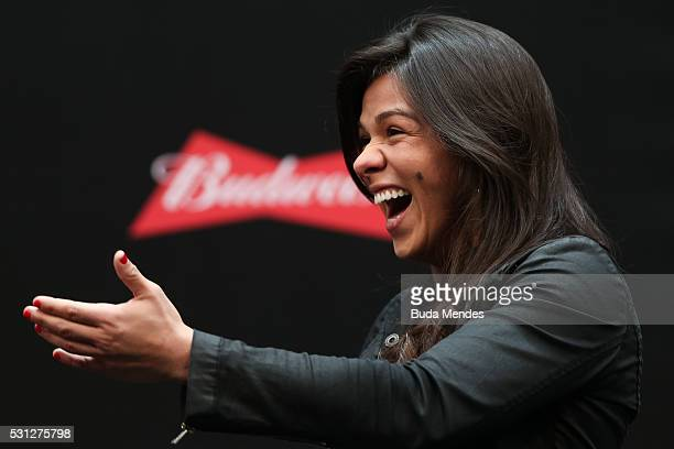 Women's strawweight fighter Claudia Gadelha of Brazil interacts with fans during a QA session before the UFC 198 weighin at Arena da Baixada stadium...
