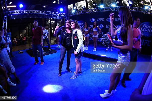 UFC women's strawweight Jessica Aguilar poses with fans at the UFC Fight Night open workout fan experience event at Nave LewisParque Fundidora on...