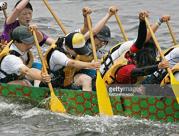 Women's team Tokyo Madona row in the final of the Sunday Challenge Cup at the Yokohama Dragon Boat Race in Yokohama 04 June 2006 Thirtytwo teams were...