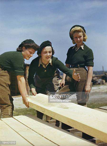 Women's Timber Corps Training Camp At Culford Suffolk Peggy Barnett a Land Army instructress training a Land Army girl at a sawmill circa 1942