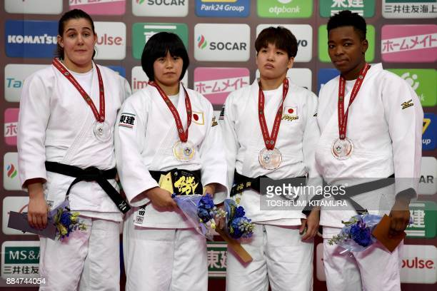 Women's under 78kg category gold medallist Shori Hamada of Japan poses with silver medallist Guusje Steenhuis of the Netherlands and bronze...