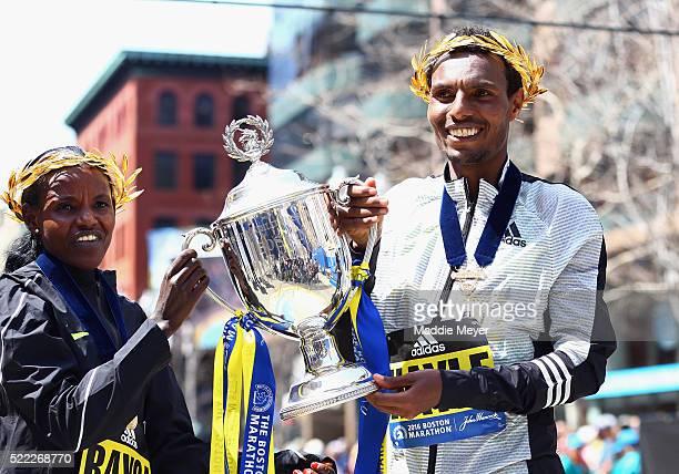Women's winner Atsede Baysa of Ethiopa and men's winner Lemi Berhanu Hayle of Ethiopia pose at the finish line after winning the 120th Boston...