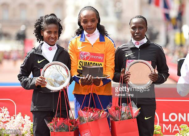 Womens winner Jemima Sumgong poses with 2nd place Tigist Tufa and 3rd place Florence Kiplagat during the Virgin London Marathon 2016 on April 24,...