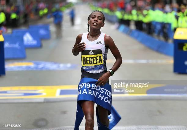 Women's winner Worknesh Degefa crosses the finish line of the 123rd Boston Marathon in Boston on April 15 2019