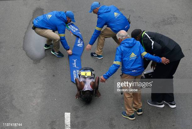 Women's winner Worknesh Degefa kisses the ground after crossing the finish line of the 123rd Boston Marathon in Boston on April 15 2019