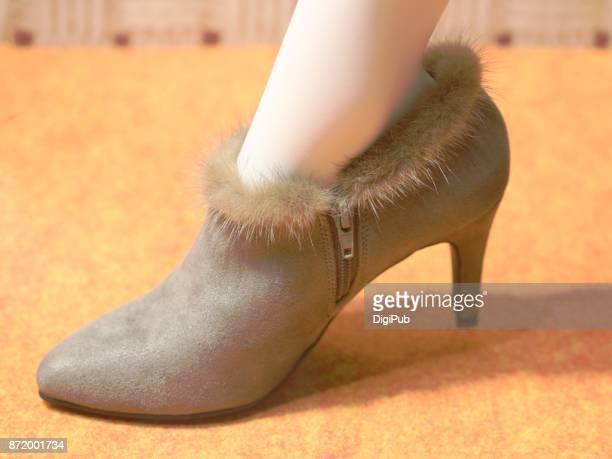 Women's winter shoe on mannequin