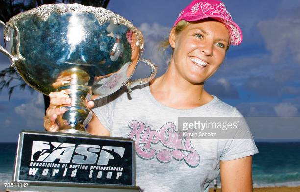 Women's World Champion Stephanie Gilmore of Australia poses with her trophy following her recent win at the Billabong Girls Pro at an impromptu press...