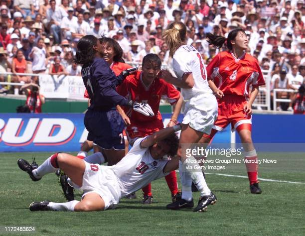 SIMON Women's World Cup 7/10/99 US player Michele Akers is hurt on this play and comes out of the game 7/10/99