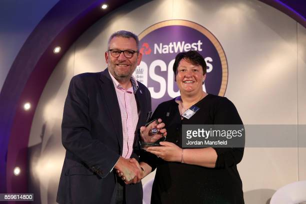 Women's World Cup Umpire Sue Redfern presents the Outstanding Contribution to Coaching Award to Bruce Storey of Northumberland during the NatWest...
