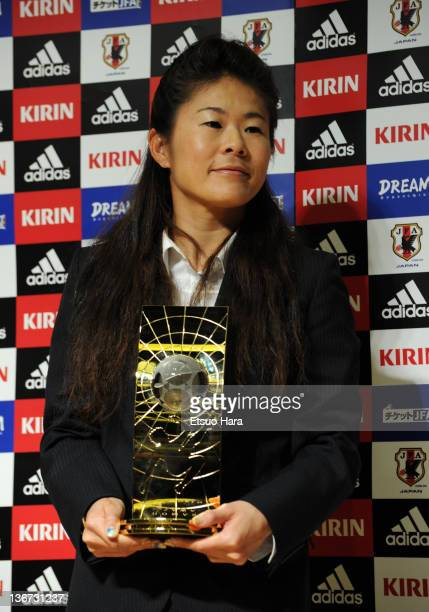 FIFA Women's World Player of the Year Homare Sawa poses for photographs with the trophy during the Ballon d'Or Press Conference at JFA House on...