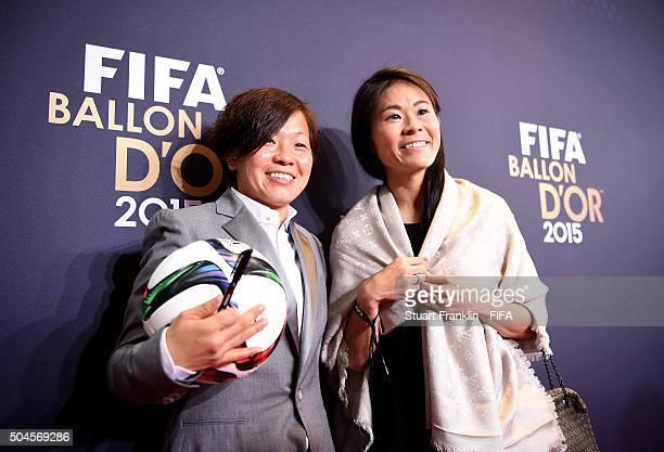 Women's World Player of the Year nominee Aya Miyama of Japan and Okayama Yunogo Belle and former Japanese international Homare Sawa arrive for the...