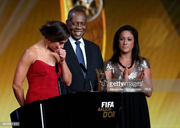 Women's World Player of the Year winner Carli Lloyd of the United States and Houston Dash accepts her award with FIFA Acting President Issa Hayatou...