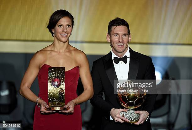 Women's World Player of the Year winner Carli Lloyd of the United States and Houston Dash poses with FIFA Ballon d'Or winner Lionel Messi of...