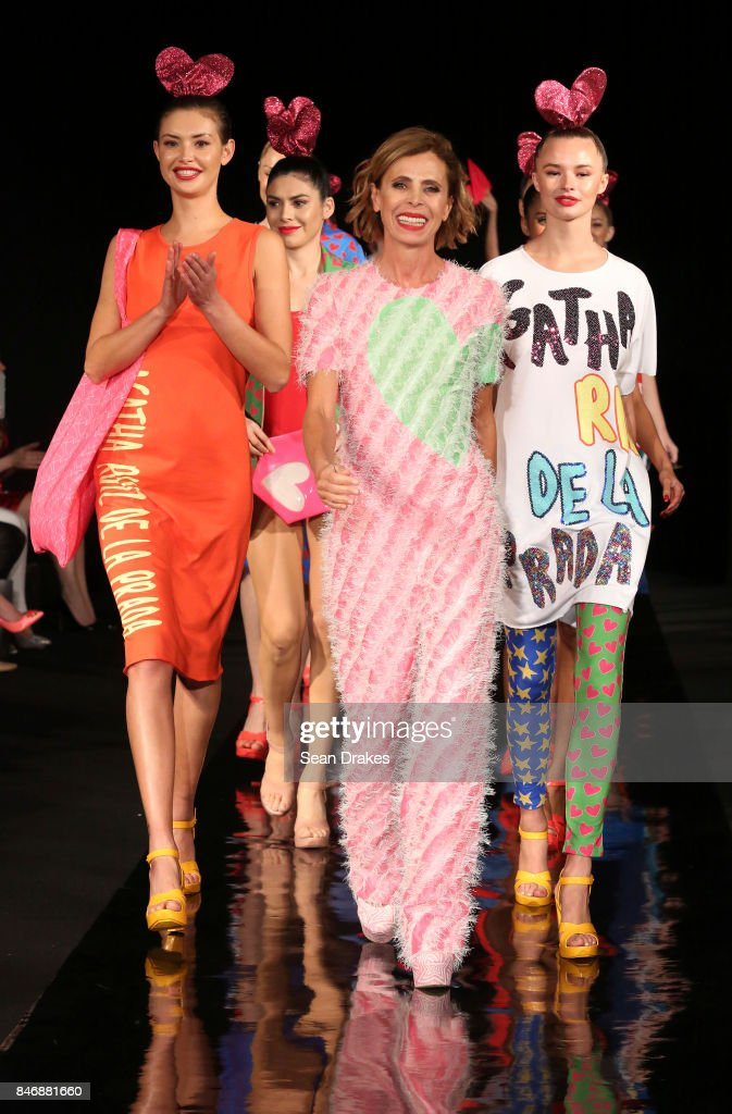 Womenswear designer Agatha Ruiz De La Prada (C) of Spain poses with models in the Fashion Designers of Latin America collection shows during New York Fashion Week at Skyline Hotel on September 13, 2017 in New York City.